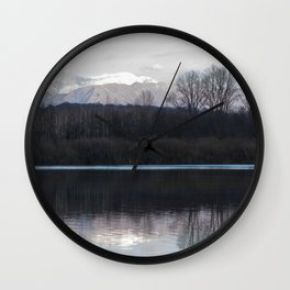 A lake in the mountains Wall Clock