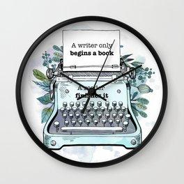 A WRITER ONLY BEGINS A BOOK Wall Clock