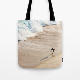 Surfer on the beach Tote Bag