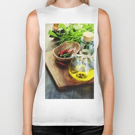 fresh  herbs, olive oil and vegetables on cutting board Biker Tank