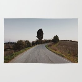 middle of the road in tuscany Rug