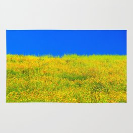 yellow poppy flower field with green leaf and clear blue sky Rug