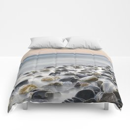 Black stones at the sea Comforters