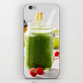 Close-up of green fresh smoothie with fruits, berries, oats and seeds, selective focus. iPhone Skin