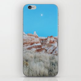 Moon Over Marbled Rock Formation iPhone Skin