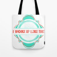 i woke up like this Tote Bags featuring Woke Up Like This by  Dreambox Designs