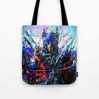 optimus prime Tote Bags featuring OPTIMUS PRIME by Raditya Giga