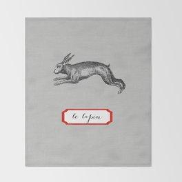 le lapin Throw Blanket