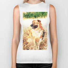 A Brown Dog Sitting In The Field Biker Tank