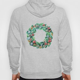 Christmas wreath. New Year decoration. Adornment coniferous green with cones, balls, snowflakes red bows. Hoody