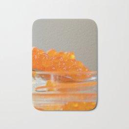 Macro shot of red caviar on jar on a gray background Bath Mat