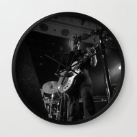queens of the stone age Wall Clocks featuring josh homme // queens of the stone age by Hattie Trott