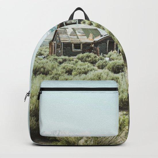 Old house in desert Backpack