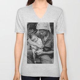 A soldier whose helmet says Swierk holds a Vietnamese child during Vietnam War Unisex V-Neck