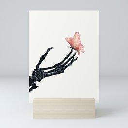 Butterfly on Skeleton Hand Mini Art Print