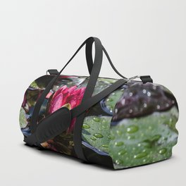 Two water lilies in the sunbeam Duffle Bag
