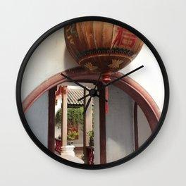 orbs over courtyard corridors Wall Clock