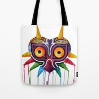 majoras mask Tote Bags featuring majoras mask by Haily Melendez