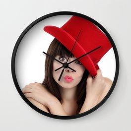 surprised woman with red top hat isolated on white background Wall Clock