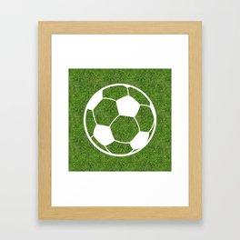 Soccer (Football) ball symbol on the grass Framed Art Print