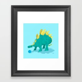 Stegosaurus and his Ball Framed Art Print