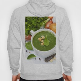 Traditional Spinach cream soup with croutons and fresh spinach leaf on top Hoody