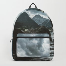 Mountains under cloudy sky Backpack