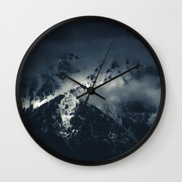 Darkness and clouds over the mountains Wall Clock