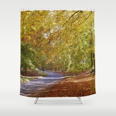 Remote country road through Autumnal woodland. Norfolk, UK. Shower Curtain