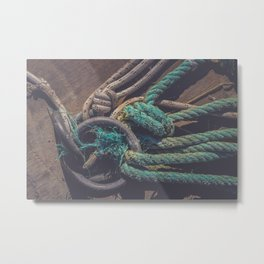 Lots of rope knots leading to moored boats Metal Print