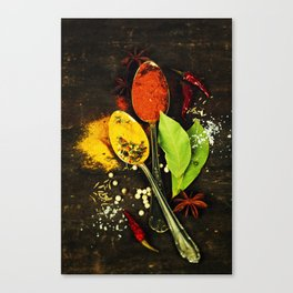 Bright spices on an old  wooden board Canvas Print