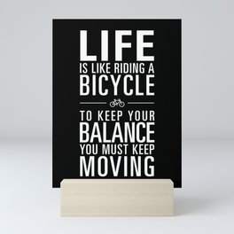 Life is like riding a bicycle. Black Background. Mini Art Print