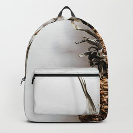 WHOLE - PINEAPPLE - ON - WHITE - MARBLE - SURFACE - PHOTOGRAPHY Backpack