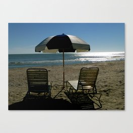 2 Chairs By The Sea.. Canvas Print