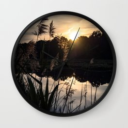 The Sun rising above the Marshlands Wall Clock