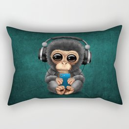 Baby Chimpanzee with Headphones Holding a Cell Phone on Blue Rectangular Pillow