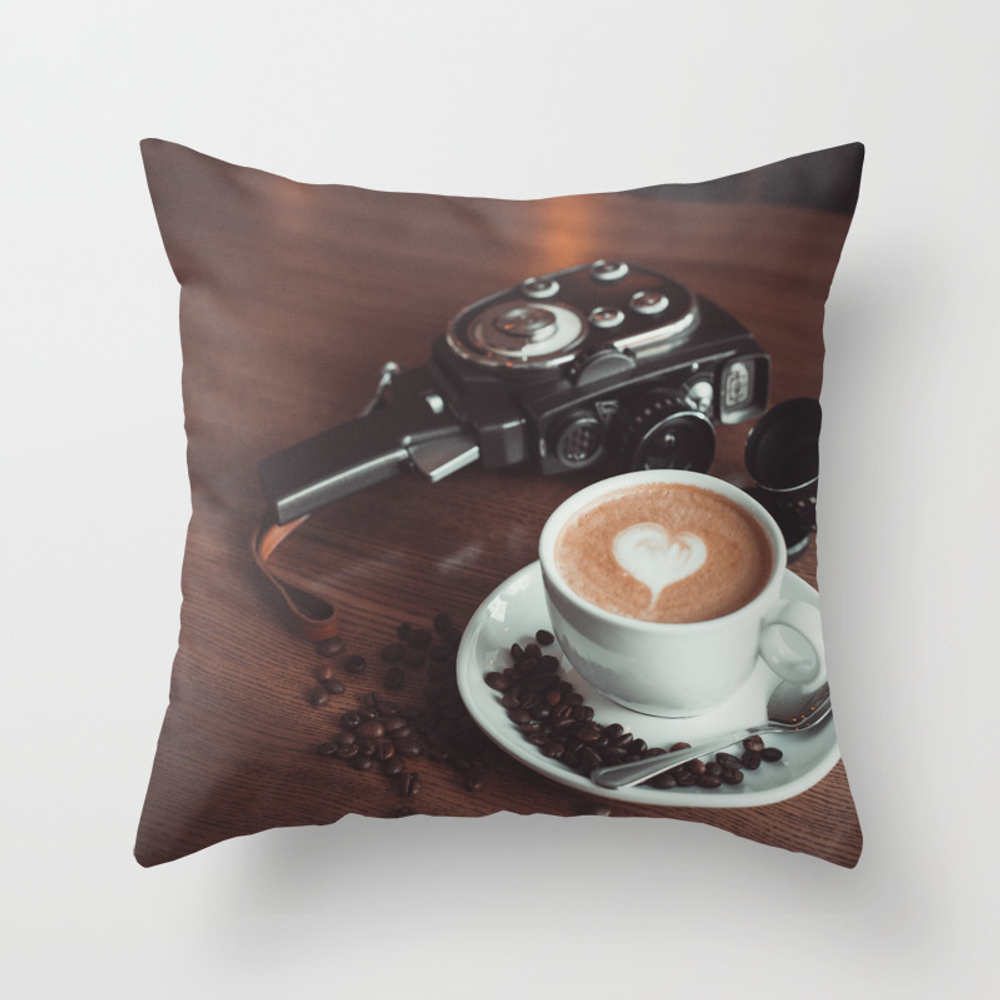 A Cup Of Hot Cappuccino Placed On A Table Next To … Throw Pillow by Maksymsymanovych PLW6583123