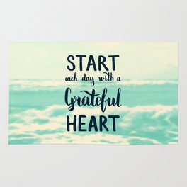 Start each day with a grateful heart Text on sea photo Rug