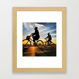 Cycling on sunset in Santa Monica, California, USA Framed Art Print