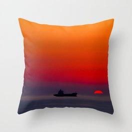 Silhouette of a ship on the ocean at red sunset with half sun ball at the horizon Throw Pillow