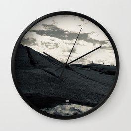 Beware of black rocks Wall Clock