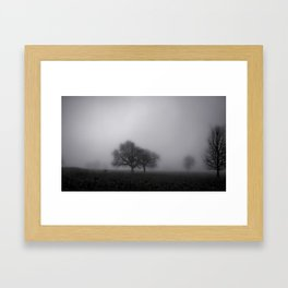 Ghostly trees in the mist Framed Art Print