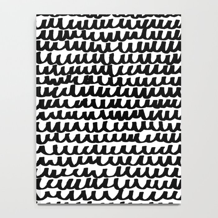 Black Wave Lines on White Notebook