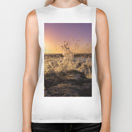 Magical sunset and waves breaking over rocky beach Biker Tank