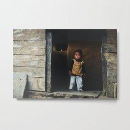 Kid in a doorway | Faces of Nepal Metal Print