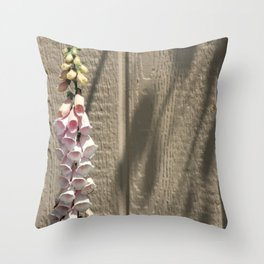 foxgloves against a garden shed Throw Pillow