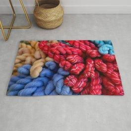 Skeins of colorful yarn Rug