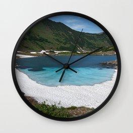 Stunning summer mountain landscape: Blue Lake, green forest on hillsides, blue sky on sunny Wall Clock