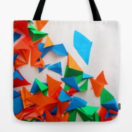 multi-colored leaflets which are cut out from paper, colourful background, collage Tote Bag