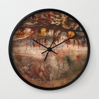 middle earth Wall Clocks featuring Middle of the Earth by Loredana